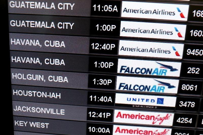 A sign shows the departure times for flights to Cuba at Miami International Airport on December 19, 2014 in Miami, Florida (AFP Photo/Joe Raedle)