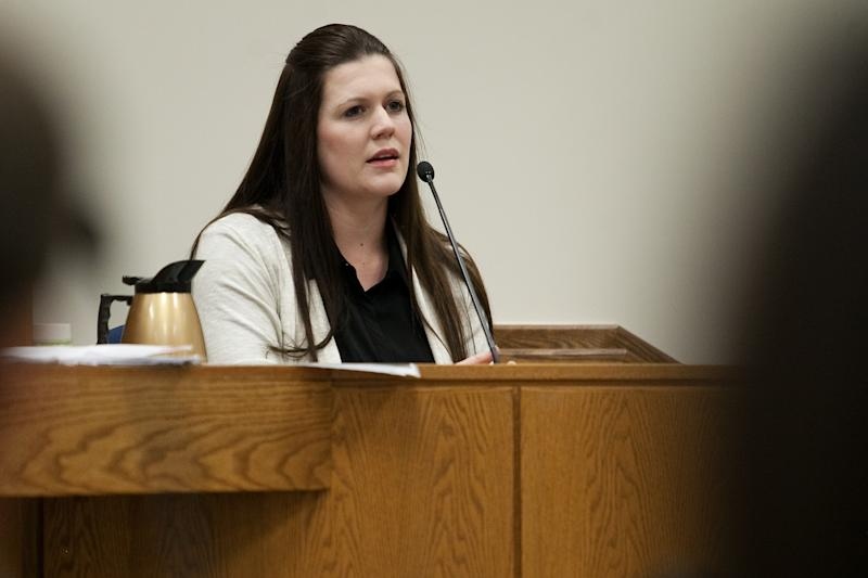 Alexis Somers testifies at the trial of her father Martin MacNeill at the Fourth District Court in Provo Wednesday, Oct. 30, 2013. Martin MacNeill is charged with murder for allegedly killing his wife Michele MacNeill in 2007. (AP Photo/Daily Herald, Mark Johnston, Pool)