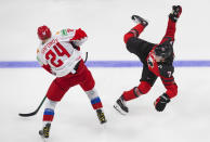 Canada's Kirby Dach (7) is checked by Russia's Ilya Safonov (24) during the third period of a game leading up to the IIHF World Junior Hockey Championships, Wednesday, Dec. 23, 2020, in Edmonton, Alberta. (Jason Franson/The Canadian Press via AP)