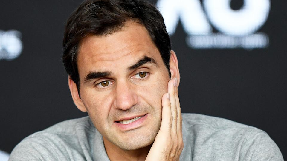 Roger Federer looks tired as he speaks during his post match press conference.