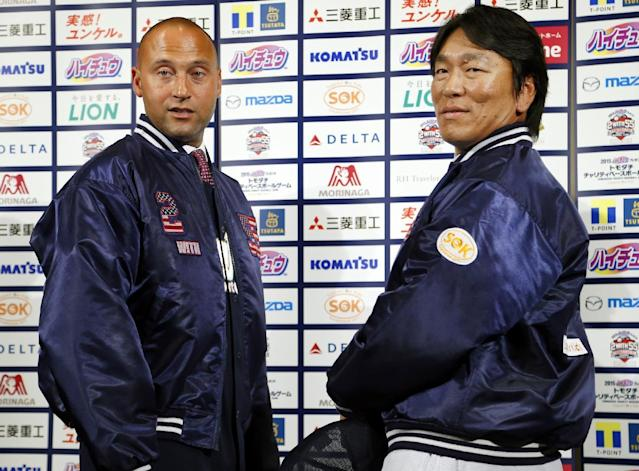 Former NY Yankees Derek Jeter, left, and Hideki Matsui pose for photographers during a press conference on a charity baseball game in Tokyo, Wednesday, March 18, 2015. Jeter is teaming up with Matsui to support the survivors of the 2011 earthquake and tsunami - and hinted he may someday get back into baseball as a team owner. The event will be held on Sunday at Tokyo Dome. (AP Photo/Shizuo Kambayashi)