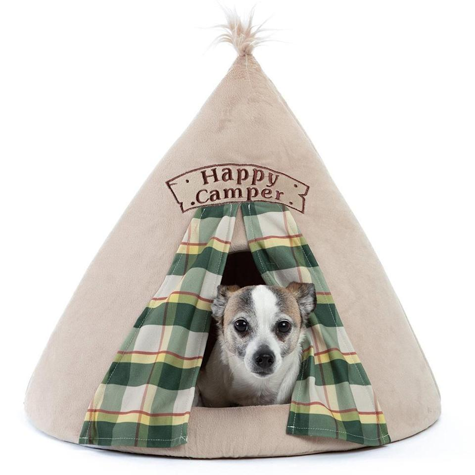 """<p><strong>Happy Camper</strong></p><p>bestfriendsbysheri.com</p><p><strong>$34.95</strong></p><p><a href=""""https://bestfriendsbysheri.com/products/happy-camper-novelty-hut-microplush-one-size?variant=19575023468601&gclid=CjwKCAjwsan5BRAOEiwALzomX-i0oeWMXkrv7QdnoxTdcrp_hLkLSlR-N8vWnD7Eva3C0TXlMBZhzBoCnfsQAvD_BwE"""" rel=""""nofollow noopener"""" target=""""_blank"""" data-ylk=""""slk:Shop Now"""" class=""""link rapid-noclick-resp"""">Shop Now</a></p><p>Let's face it, anyone can appreciate some extra privacy, and your pet is no exception. Allow them to draw back the curtains on this tent-inspired bed for some much needed alone time. </p>"""