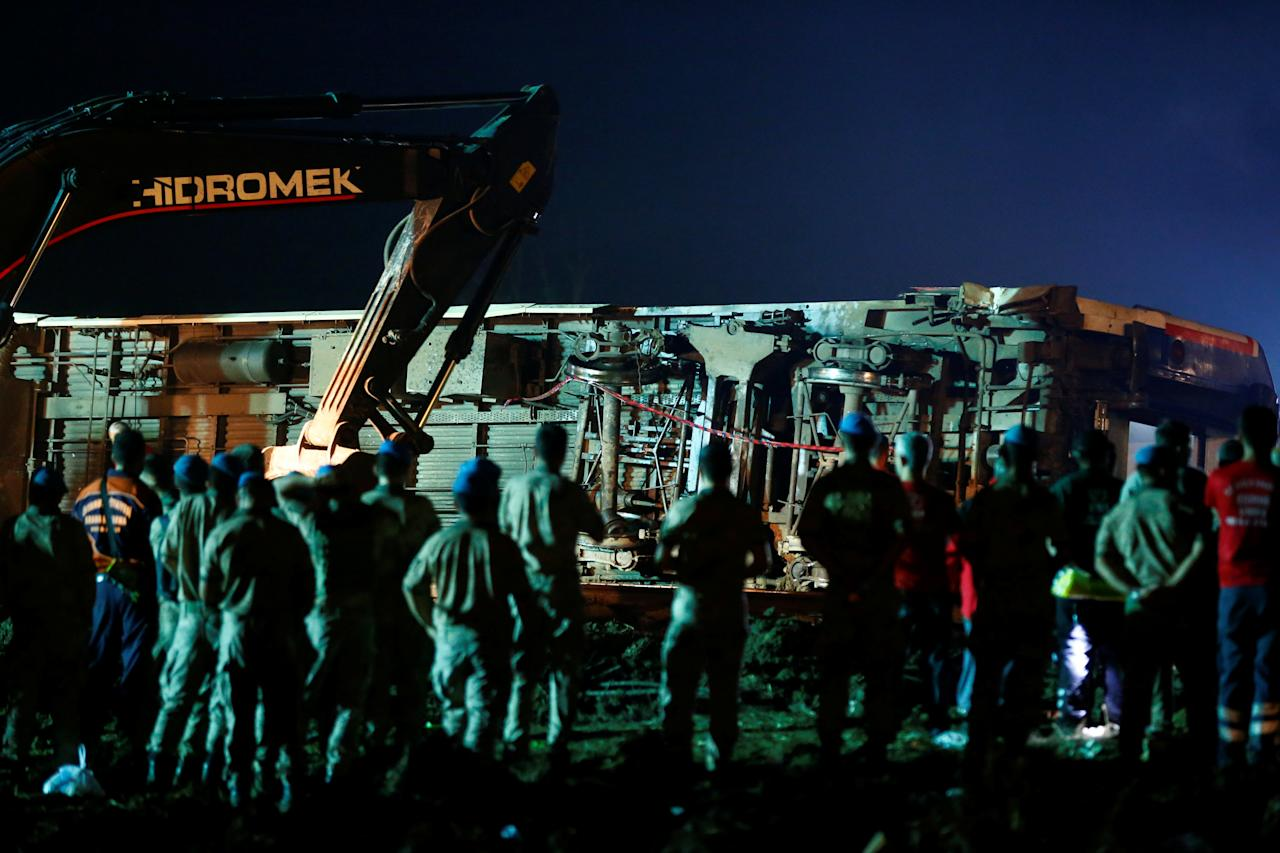 <p>Rescue workers and paramedics work at the site of a train derailment near Corlu in Tekirdag province, Turkey, July 9, 2018. (Photo: Osman Orsal/Reuters) </p>