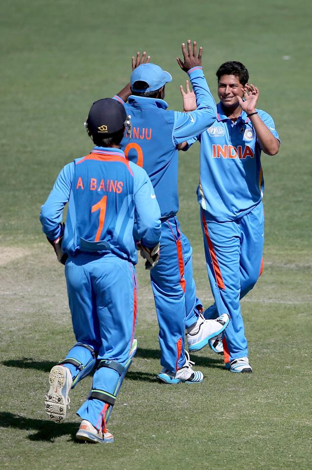 DUBAI, UNITED ARAB EMIRATES - FEBRUARY 17:  Kuldeep Yadav of India celebrates with teammates after dismissing Nick Farrar of Scotland  during the ICC U19 Cricket World Cup 2014 match between India and Scotland at the Dubai Sports City Cricket Stadium on February 17, 2014 in Dubai, United Arab Emirates.  (Photo by Francois Nel - IDI/IDI via Getty Images)