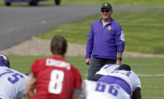 Minnesota Vikings head coach Mike Zimmer enjoys a laugh during practice at the NFL football team's training camp in Eagan, Minn., Thursday, June 14, 2018. (AP Photo/Jim Mone)