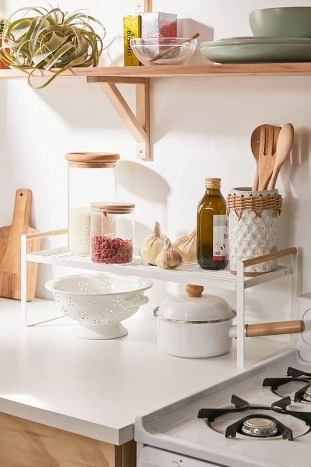 "<p>If you only have a very tiny amount of counter space to work with, make sure it's working as hard as possible. To instantly double your counter space, add this shelf that can hold the tools and ingredients you reach for daily (note: this works best for kitchens without low-hanging cabinets). </p> <p><strong>To buy: </strong>$49, <a href=""https://click.linksynergy.com/deeplink?id=93xLBvPhAeE&mid=43176&murl=https%3A%2F%2Fwww.urbanoutfitters.com%2Fshop%2Fmetal-kitchen-shelf&u1=RS%2C7OrganizersAllSmall-SpaceDwellersShouldOwn%2Ckholdefehr1271%2CORG%2CIMA%2C684656%2C201911%2CI"" target=""_blank"">urbanoutfitters.com</a>. </p>"