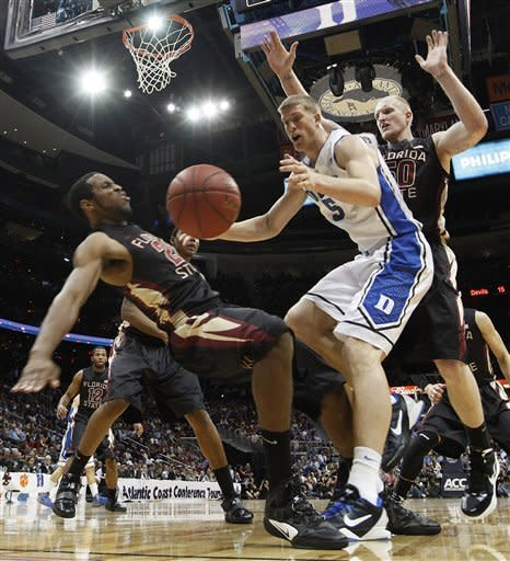 Duke forward Mason Plumlee (5) collides with Florida State guard Michael Snaer (21) as Florida State center Jon Kreft (50) looks on during the first half of an NCAA college basketball game in the semifinals of the Atlantic Coast Conference tournament, Saturday, March 10, 2012, in Atlanta. (AP Photo/John Bazemore)