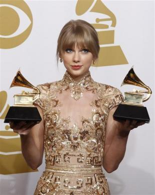 "Taylor Swift holds her Grammys for Best Country Song and Best Country Solo Performance (""Mean"") at the 54th annual Grammy Awards in Los Angeles, California February 12, 2012."
