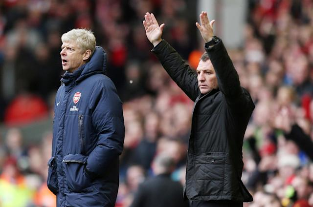 FILE PHOTO: Soccer Football - Liverpool v Arsenal - Barclays Premier League - Anfield - February 8, 2014 Liverpool manager Brendan Rodgers (R) and Arsenal manager Arsene Wenger Action Images via Reuters/Carl Recine/File Photo EDITORIAL USE ONLY. No use with unauthorized audio, video, data, fixture lists, club/league logos or live services. Online in-match use limited to 45 images, no video emulation. No use in betting, games or single club/league/player publications. Please contact your account representative for further details.
