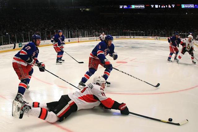 NEW YORK, NY - APRIL 26: Daniel Alfredsson #11 of the Ottawa Senators falls to the ice against the defense of Brandon Dubinsky #17 of the New York Rangers in the third period of Game Seven of the Eastern Conference Quarterfinals during the 2012 NHL Stanley Cup Playoffs at Madison Square Garden on April 26, 2012 in New York City. (Photo by Bruce Bennett/Getty Images)