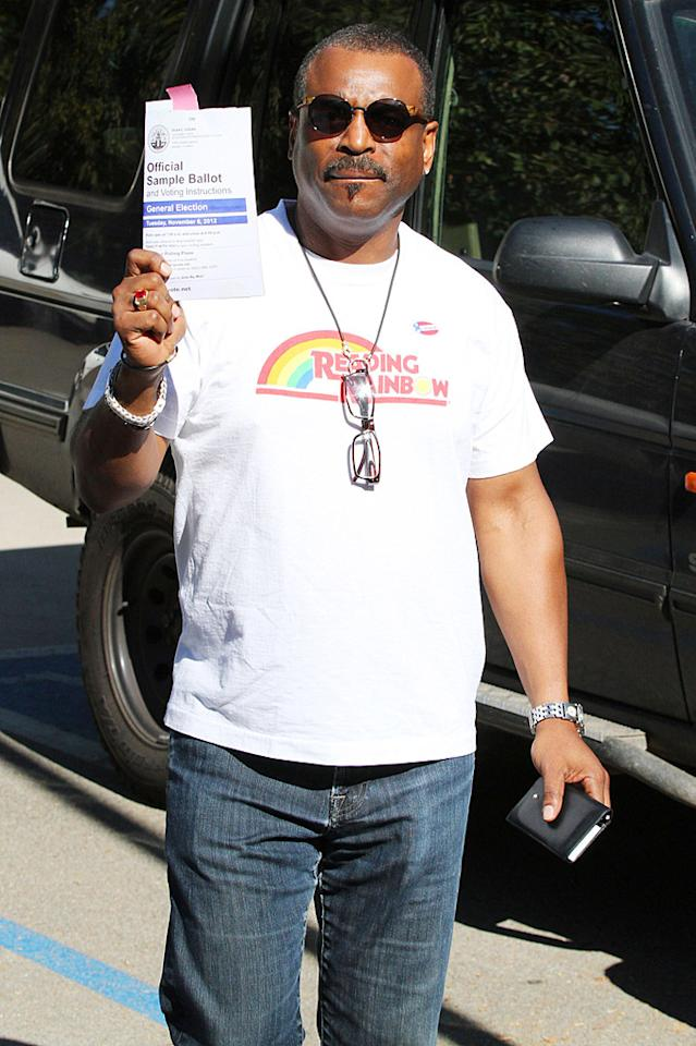 """It's probably safe to say that """"Reading Rainbow"""" icon LeVar Burton voted for Obama since Romney remarked during the debates that he would cut funding to PBS, Burton's employer. The actor proudly showed his love for the non-profit network by wearing a """"Reading Rainbow"""" T-shirt at an L.A. polling station today. (11/6/2012)"""