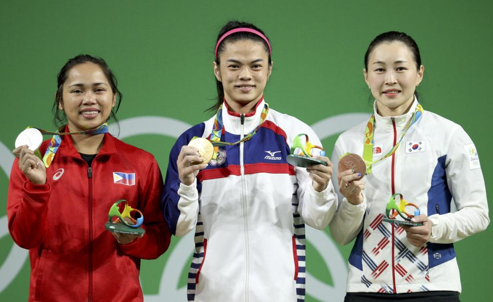 2016 Rio Olympics - Weightlifting - Victory Ceremony - Women's 53kg Victory Ceremony - Riocentro - Pavilion 2 - Rio de Janeiro, Brazil - 07/08/2016. Hidilyn Diaz (PHI) of Philippines, Hsu Shu-Ching (TPE) of Taiwan, and Yun Jin-Hee (KOR) of South Korea pose with their medals. REUTERS/Stoyan Nenov FOR EDITORIAL USE ONLY. NOT FOR SALE FOR MARKETING OR ADVERTISING CAMPAIGNS.