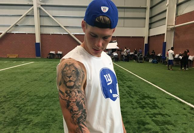"""<p>Brad Wing, P, New York Giants. """"I have eight tattoos. All but one of them are faith-based, with some kind of religious background. This one here is the archangel Michael. He's the angel who ultimately defeated Satan and sent him to hell. That is, in my opinion, one of the pivotal points in the history of the Bible. He's my favorite archangel. And then the Lion here—people always ask me if I'm a Leo. That's not what that is. It's to kind of represent God. You know, everyone has a different vision of what God looks like. No one is certain of what he looks like. I used the Lion to represent him there. Top of the food chain, that's why he's on the highest point of my arm. I won't get anything above that.""""</p>"""