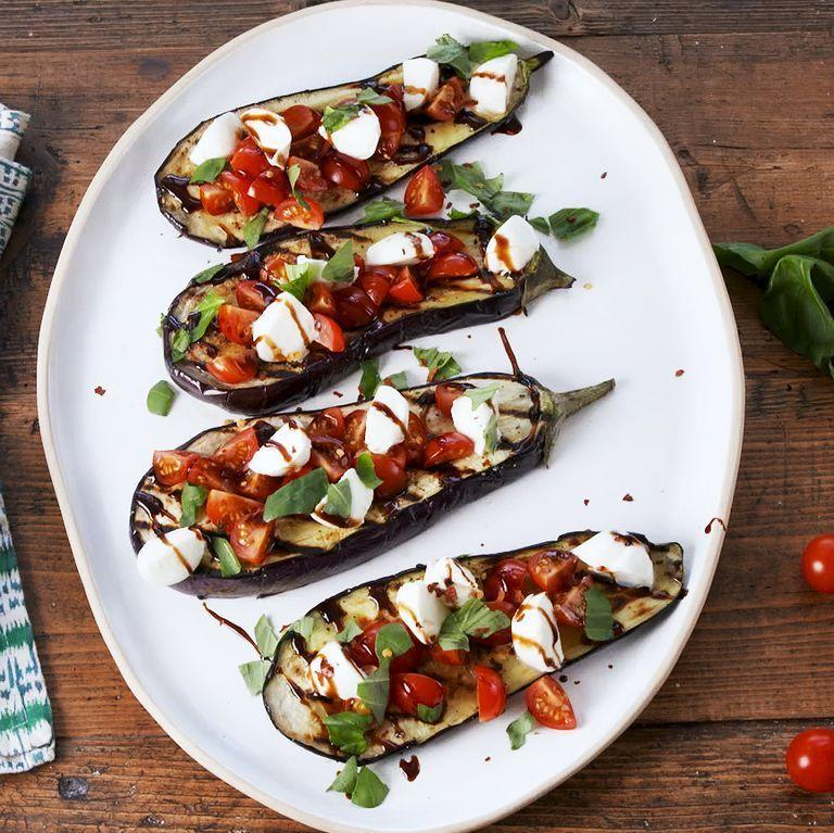 "<p>Grill these eggplant steaks until they have a nice char, then top with a caprese-inspired mixture of mozzarella, tomato, basil, and balsamic. You won't be able to stop yourself from going back for more. </p><p><strong><em>Get the recipe at <a href=""https://www.delish.com/cooking/recipe-ideas/a28207209/caprese-eggplant-steaks-recipe/"" rel=""nofollow noopener"" target=""_blank"" data-ylk=""slk:Delish"" class=""link rapid-noclick-resp"">Delish</a>.</em></strong></p>"