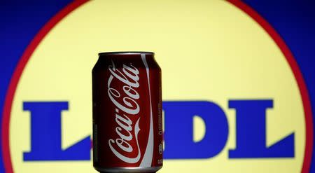 A can of Coca-Cola is seen in front of the Lidl logo in this photo illustration taken in Sarajevo