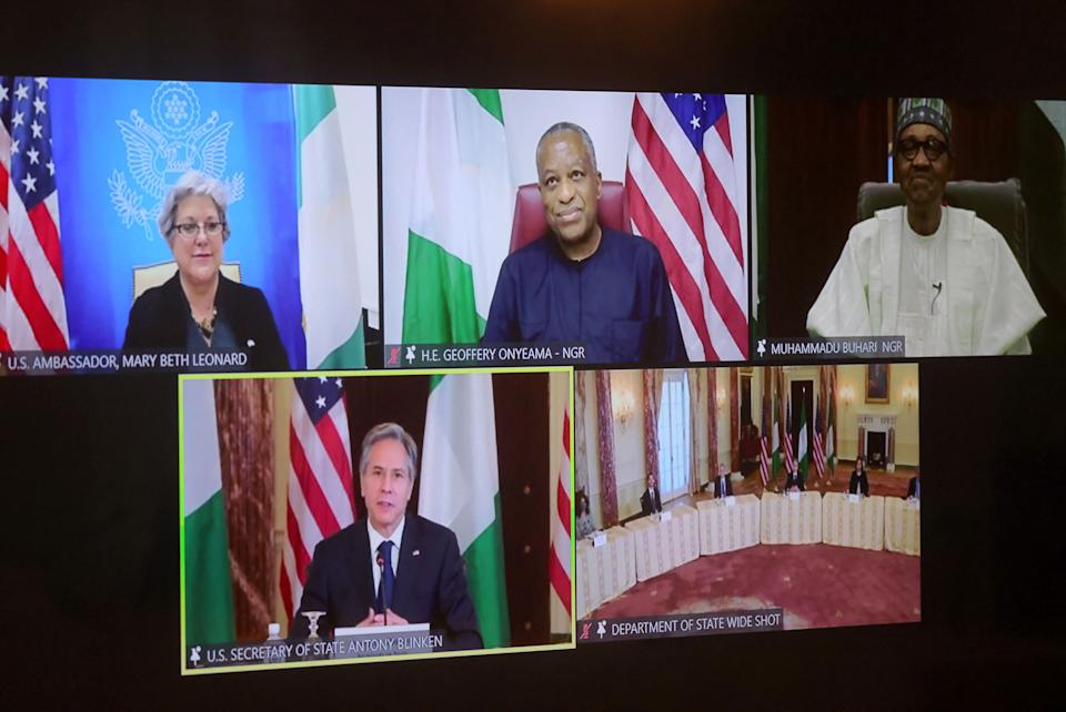 US Secretary of State Antony Blinken and staff members participate in a virtual bilateral meeting with Nigeria's President Muhammadu Buhari during a videoconference at the State Department in Washington, DC on April 27, 2021. - US Secretary of State Antony Blinken on April 27, 2021 cautioned Africa to beware of China's growing role as he vowed a greater US commitment in talks with Nigeria and Kenya. (Photo by LEAH MILLIS / POOL / AFP) (Photo by LEAH MILLIS/POOL/AFP via Getty Images)