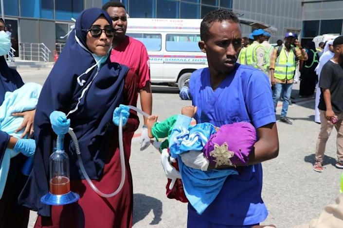 Nurses help a child wounded in the December 28, 2019 car bomb explosion in Mogadishu before being evacuated to Turkey for medical treatment (AFP Photo/Abdirazak Hussein FARAH)