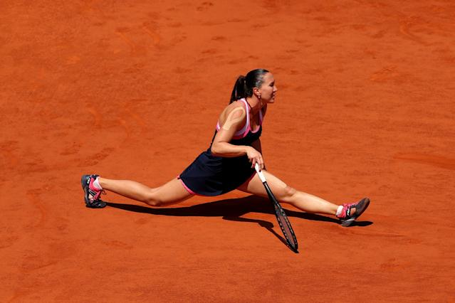 PARIS, FRANCE - JUNE 05: Jelena Jankovic of Serbia slips after stretching to play a forehand during her Women's Singles quarter final match against Maria Sharapova of Russia on day eleven of the French Open at Roland Garros on June 5, 2013 in Paris, France. (Photo by Clive Brunskill/Getty Images)