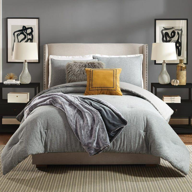 """<p><strong>Ayesha Curry</strong></p><p>theknot.com</p><p><strong>$169.99</strong></p><p><a href=""""https://go.redirectingat.com?id=74968X1596630&url=https%3A%2F%2Fwww.theknot.com%2Fregistry%2Fstore%2Fproducts%2Fasher-comforter-set%3Fid%3D102198&sref=https%3A%2F%2Fwww.housebeautiful.com%2Fshopping%2Fhome-accessories%2Fg36318062%2Fwedding-gifts-couples-want-2021%2F"""" rel=""""nofollow noopener"""" target=""""_blank"""" data-ylk=""""slk:BUY NOW"""" class=""""link rapid-noclick-resp"""">BUY NOW</a></p><p>Who doesn't love a new bedding look? This light gray set by Ayesha Curry includes a comforter and two shams made of 100 percent cotton. It's simple yet sophisticated and can work with any existing sheet set.</p>"""