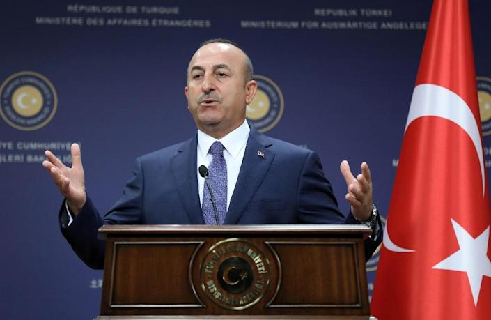 """Turkish Foreign Minister Mevlut Cavusoglu said Athens and the Greek Cypriot side had to """"wake up"""" from the notion that Ankara would withdraw its troops (AFP Photo/ADEM ALTAN)"""