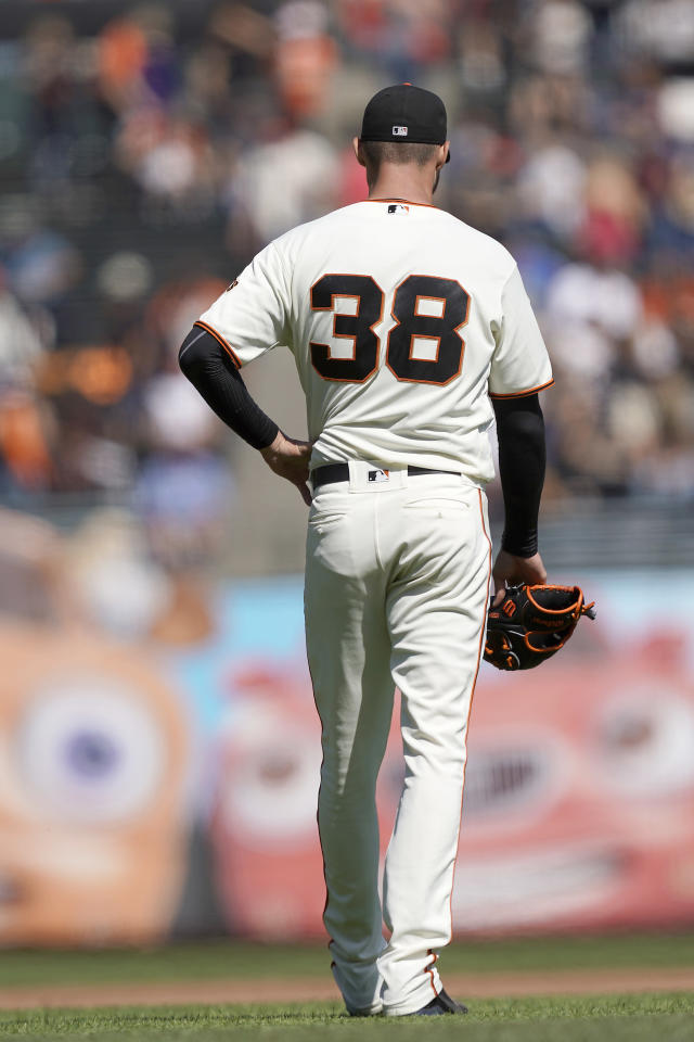 San Francisco Giants pitcher Tyler Beede holds his side after a throw against the Colorado Rockies during the fourth inning of a baseball game Thursday, Sept. 26, 2019, in San Francisco. Tyler Beede was taken out of the game. (AP Photo/Tony Avelar)