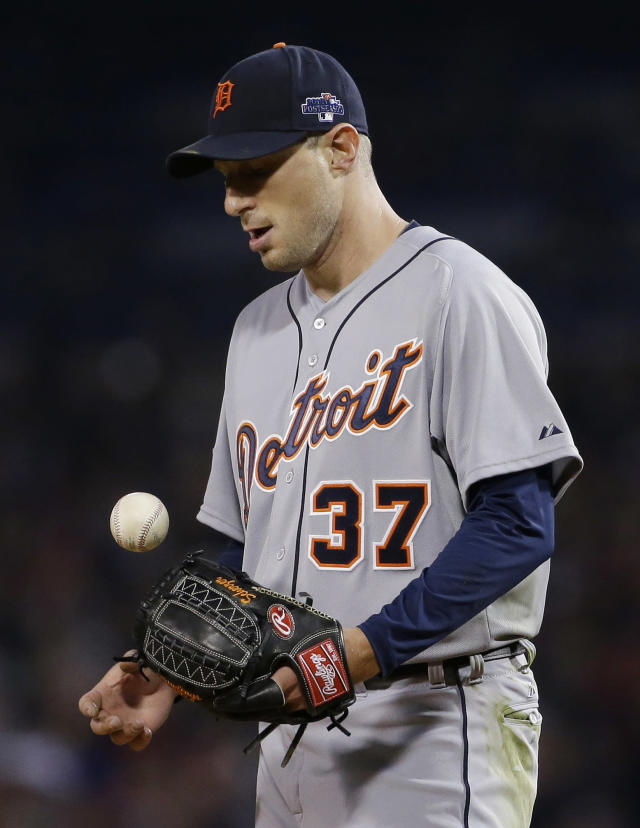 Detroit Tigers starting pitcher Max Scherzer flips the ball after Boston Red Sox shortstop Xander Bogaerts scored the first run of the game in the fifth inning during Game 6 of the American League baseball championship series on Saturday, Oct. 19, 2013, in Boston. (AP Photo/Matt Slocum)
