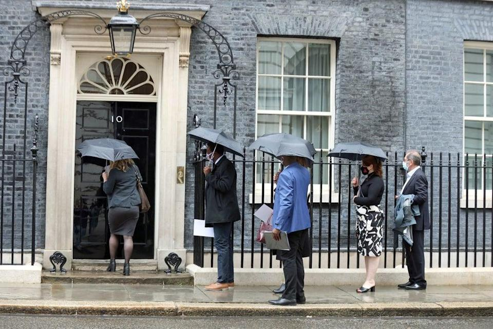 Members of the Covid-19 Bereaved Families for Justice group arrive in Downing Street for a private meeting with the prime minister (PA)