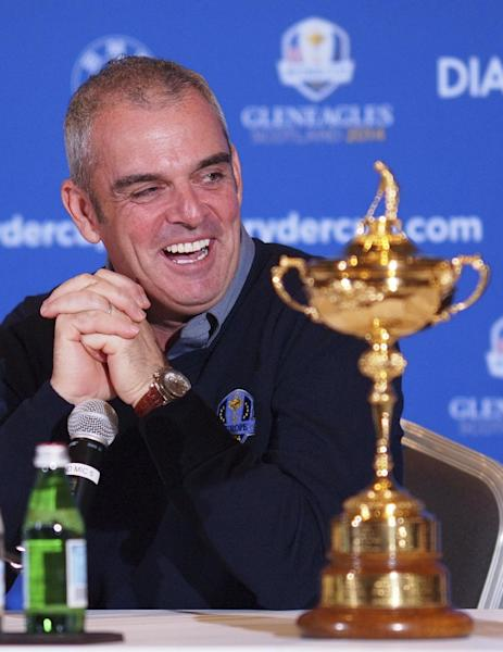 Paul McGinley of Ireland speaks from behind the Ryder Cup after being nominated Captain for the 2014 European Ryder Cup Team following a meeting of the Tournament Committee of the European Tour in Abu Dhabi, United Arab Emirates, Tuesday, Jan. 15, 2013. (AP Photo/Manuel Salazar)