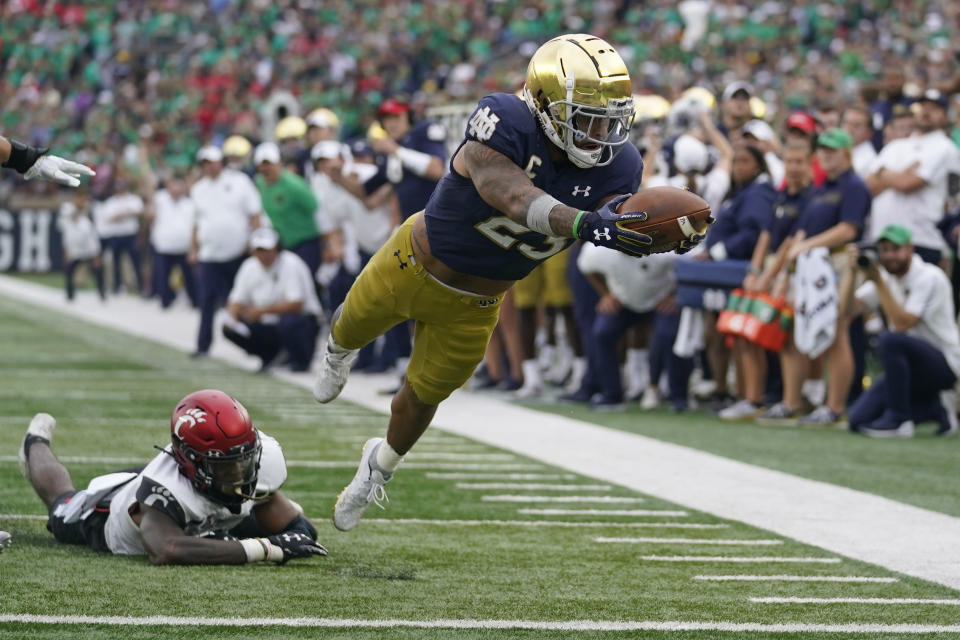 Notre Dame's Kyren Williams (23) dives into the end zone for a touchdown during the second half of an NCAA college football game against Notre Dame, Saturday, Oct. 2, 2021, in South Bend, Ind. Cincinnati won 24-13. (AP Photo/Darron Cummings)