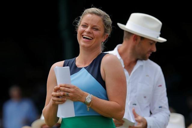 Kim Clijsters of Belgium and Andy Roddick of the U.S. take their seats before being inducted into the International Tennis Hall of Fame in Newport