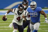 Houston Texans quarterback Deshaun Watson (4) is chased by Detroit Lions defensive end Everson Griffen (98) during the first half of an NFL football game, Thursday, Nov. 26, 2020, in Detroit. (AP Photo/Paul Sancya)