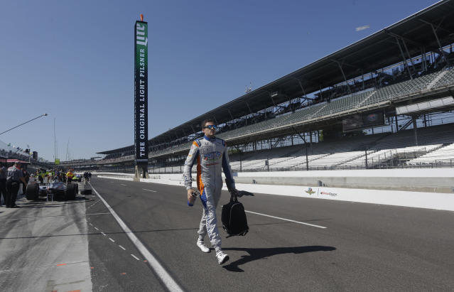 Stefan Wilson, of England, walks to his car before the start of the final practice session for the IndyCar Indianapolis 500 auto race at Indianapolis Motor Speedway, in Indianapolis Friday, May 25, 2018. (AP Photo/AJ Mast)