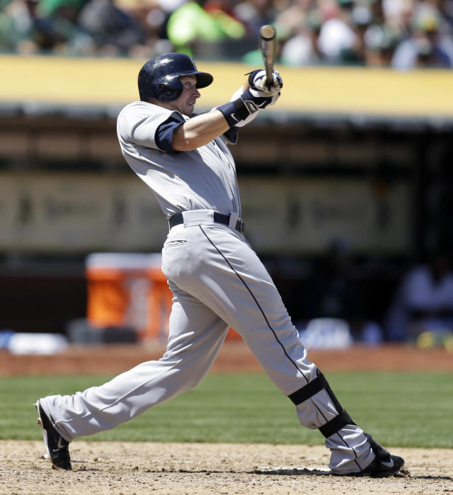 Seattle Mariners' Justin Smoak swings for an RBI sacrifice fly off Oakland Athletics' Dan Straily in the fifth third inning of a baseball game Wednesday, May 7, 2014, in Oakland, Calif. (AP Photo/Ben Margot)