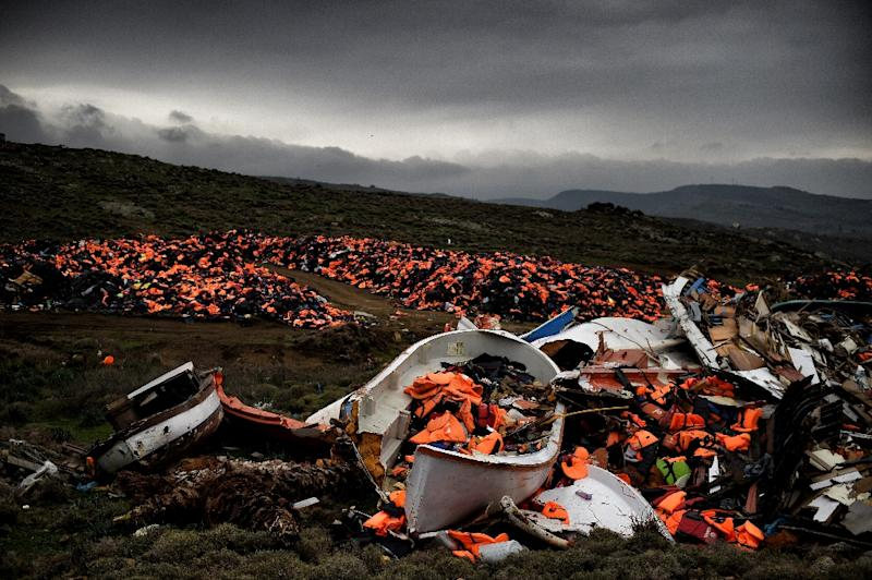 Wrecked boats and thousands of life jackets used by refugees and migrants during their journey across the Aegean sea lie in a dump in Mithimna (AFP Photo/Aris Messinis)