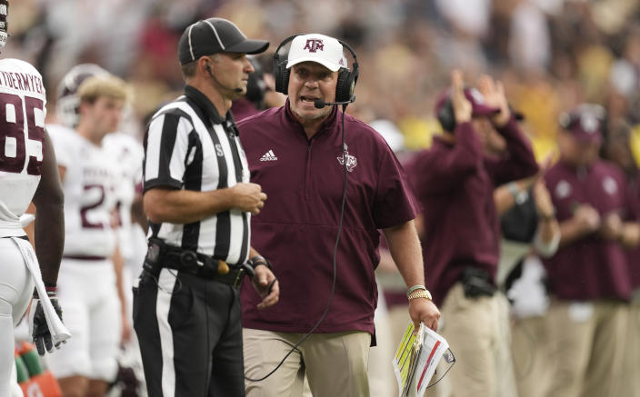 Texas A&M head coach Jimbo Fisher argues with a referee in the second half of an NCAA college football game against Colorado, Saturday, Sept. 11, 2021, in Denver. Texas A&M won 10-7. (AP Photo/David Zalubowski)
