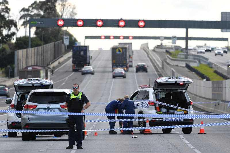 Forensic investigators attend the scene of a shooting along the Monash Freeway in Melbourne.