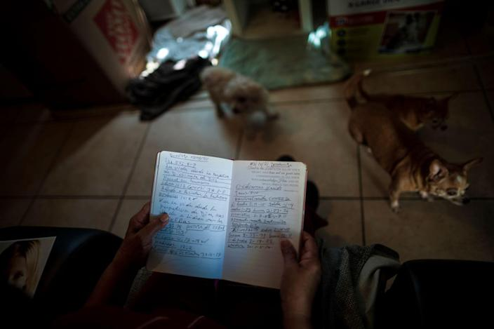 Elsa Romero jots notes during her pastor's sermons, then reviews them at home.