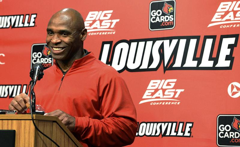 Louisville head football coach Charlie Strong smiles at a reporters question during a news conference Thursday, Dec. 6, 2012, in Louisville, Ky. Strong announced this morning that he has turned down the head coaching job offer from the University of Tennessee and will stay at Louisville. (AP Photo/Timothy D. Easley)