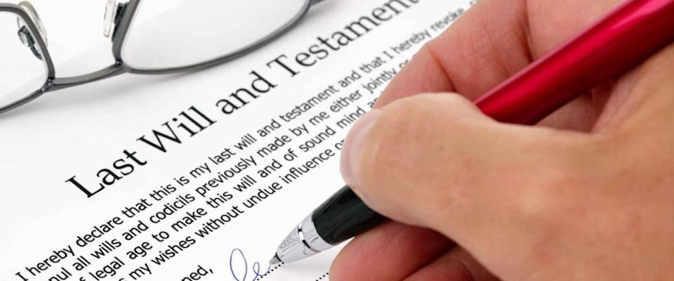 Close-up on signing a last will and will document