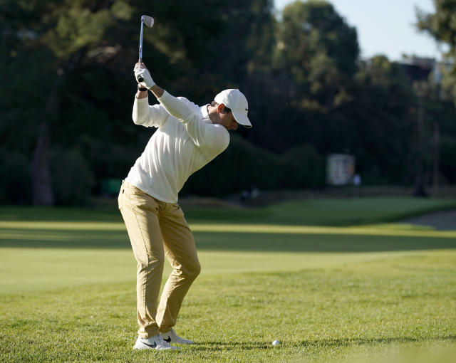 Rory McIlroy, of Northern Ireland, hits his second shot on the 13th hole during the first round of the Genesis Invitational golf tournament at Riviera Country Club, Thursday, Feb. 13, 2020, in the Pacific Palisades area of Los Angeles. (AP Photo/Ryan Kang)