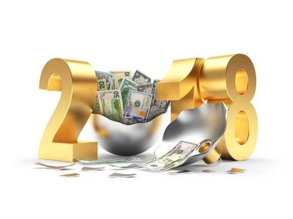 The number 2018, with the 2, 1, and 8 in gold and a silver ornament for the zero, opened and overflowing with cash