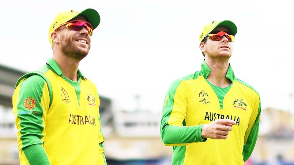 Steve Smith (pictured right) and David Warner (pictured left) walk off the field.