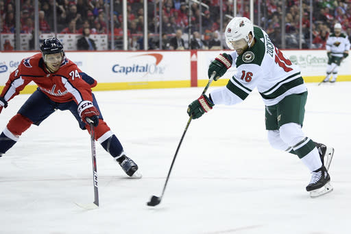 Minnesota Wild left wing Jason Zucker (16) shoots against Washington Capitals defenseman John Carlson (74) during the first period of an NHL hockey game Friday, March 22, 2019, in Washington. (AP Photo/Nick Wass)