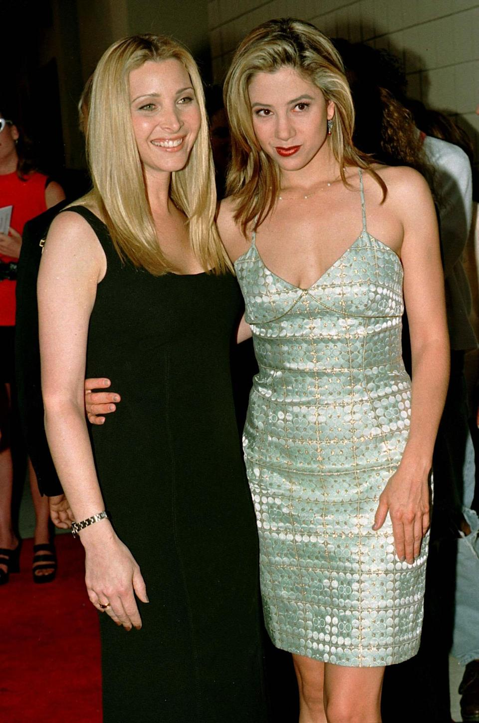 Actresses Lisa Kudrow (L) and Mira Sorvino pose as they arrive for the premiere of their new film