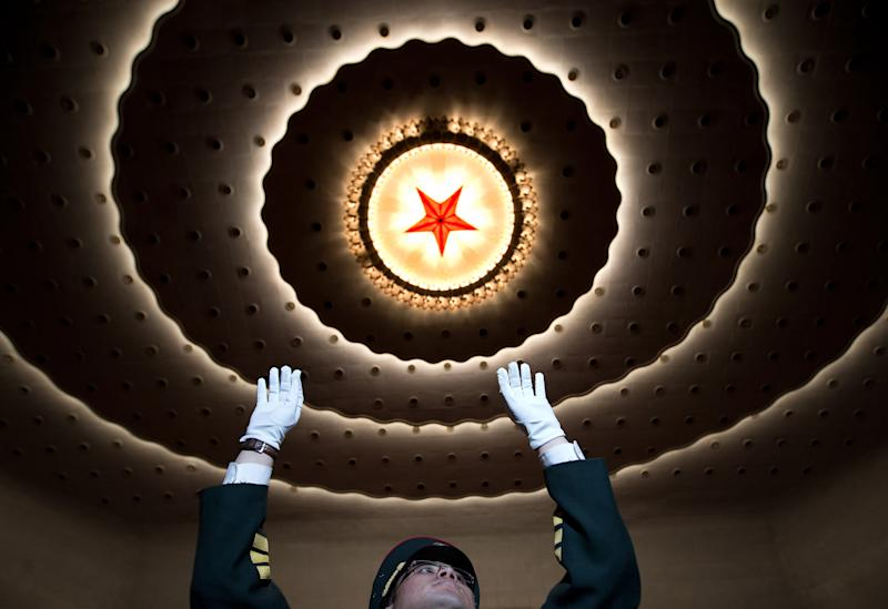 A military band conductor rehearses before the opening session of the Chinese People's Political Consultative Conference in Beijing's Great Hall of the People Sunday, March 3, 2013. (AP Photo/Andy Wong)