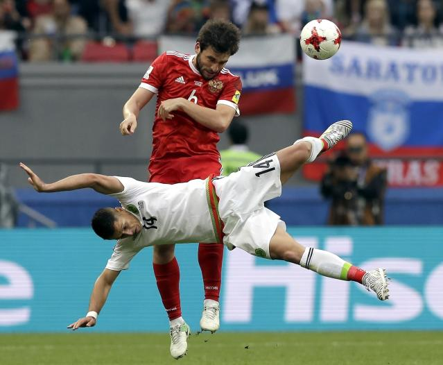 FILE - In this Saturday, June 24, 2017 filer, Mexico's Javier Hernandez, front, and Russia's Georgii Dzhikiia, rear, challenge for the ball during the Confederations Cup, Group A soccer match between Mexico and Russia, at the Kazan Arena, Russia. (AP Photo/Thanassis Stavrakis, File)