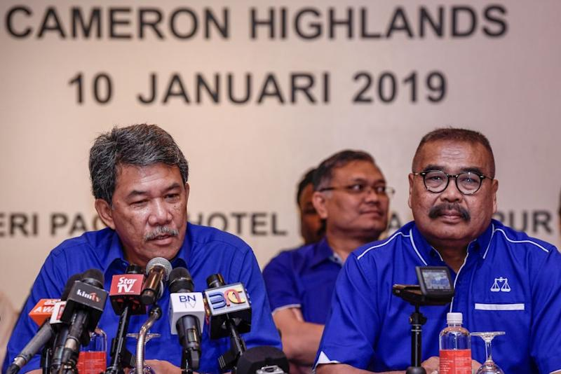 BN deputy chairman Datuk Seri Mohamad Hasan speaks during a press conference at the Seri Pacific Hotel Kuala Lumpur as Cameron Highlands candidate Ramli Mohd Noor looks on. — Picture by Hari Anggara