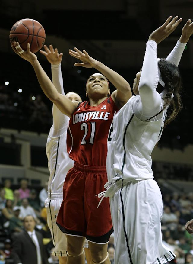 Louisville guard Bria Smith (21) goes to the basket between South Florida guard Inga Orekhova, left, and center Akila McDonald, right, during the first half of an NCAA college basketball game on Sunday, Jan. 12, 2014, in Tampa, Fla. (AP Photo/Chris O'Meara)