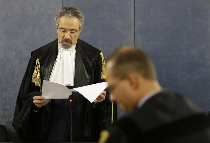 Court president Oscar Magi reads a sentence in Milan's court, Italy, Thursday, March 7, 2013. A Milan court has convicted former Premier Silvio Berlusconi for the illegal publication of transcripts of wiretapped conversations in a newspaper owned by his media empire. The court on Thursday sentenced him to one year in jail, although he is unlikely to be put behind bars during a possible appeal. (AP Photo/Luca Bruno)