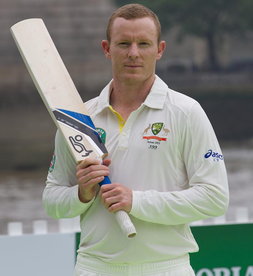 Australian cricketer Chris Rogers poses for a photo after playing a game of cricket on a barge in the river Thames by Tower Bridge in central London on June 20, 2013. AFP PHOTO/ANDREW COWIE        (Photo credit should read ANDREW COWIE/AFP/Getty Images)